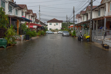 thailand flood: Bangkok, Thailand - May 15, 2016 : Water flood village in Don Mueang district. Problem with the drainage system.