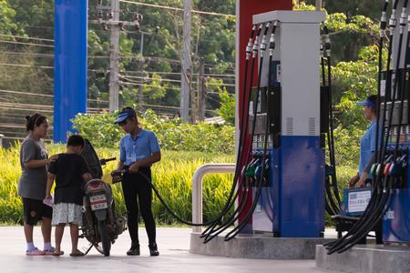 fuel pumps: Bangkok, Thailand - March 13, 2016 : Fuel pumps at a petrol gas station