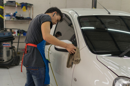 buffing: Bangkok, Thailand - January 16, 2016 : Unidentified car care staff cleaning the car.