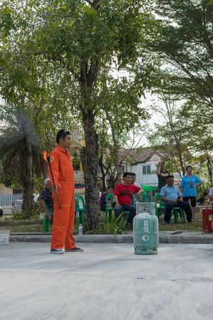 preparedness: Bangkok, Thailand - January 31, 2016 : Many people preparedness for fire drill and training to use a fire safety tank in village at Bangkok Thailand. Editorial