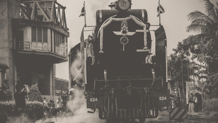 reminisce: Bangkok, Thailand - March 26, 2016 : Steam train at Foundation Day of train operation 119 years anniversary of the State Railway of Thailand. , process in vintage black and white style