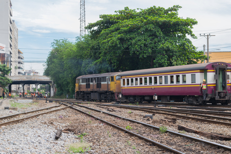 cheaper: Bangkok, Thailand - September 5, 2015 : Unidentified railway train on the railroad tracks in Bangkok station. Many people in Thailand popular travel by train because it is cheaper. Editorial