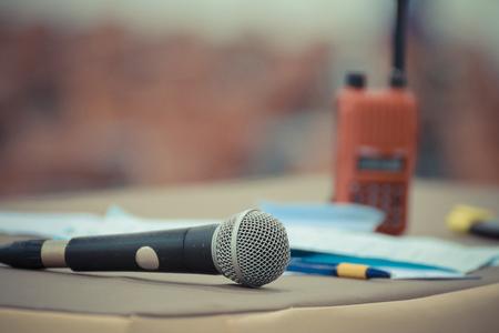 talkie: Microphone in seminar event defocus on walkie talkie (radio communication) and meeting room background Stock Photo