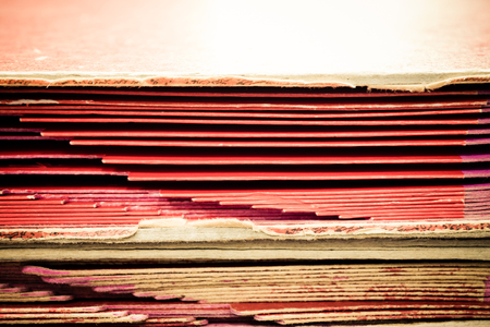 disorganization: Files in old folder stacking up in a messy order.