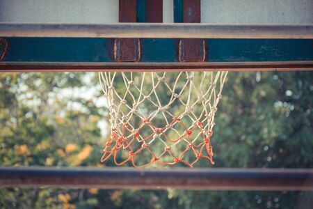 ball park: Basketball hoop make by wooden and ball in park , process in vintage style
