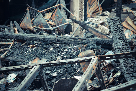 conflagration: Conflagration fire damaged in summer house after blaze , process in vintage style Stock Photo