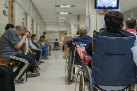 Patient elderly on wheelchair and many patient waiting a doctor and nurse in hospital Reklamní fotografie - 58236654