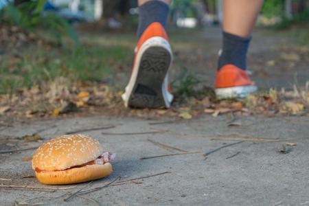 good bye: Good bye junk food hamburger left to jogging exercise