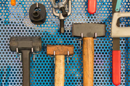 tidy: Collection of hammer tools tidy on board in garage