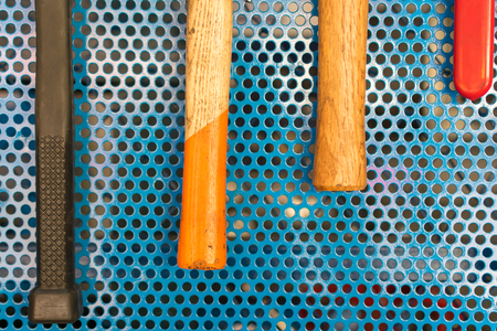 peg board: Collection of hammer tools tidy on board in garage