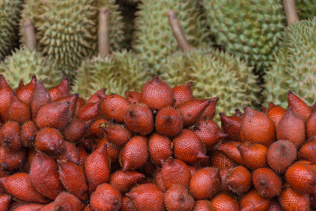 Thai exotic fruits (Salak and Durian) in market. Like the charming people, exotic fruit greets you on almost every corner in Thailand.