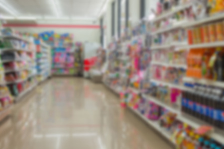 Blurred of Many types of goods in convenience store.