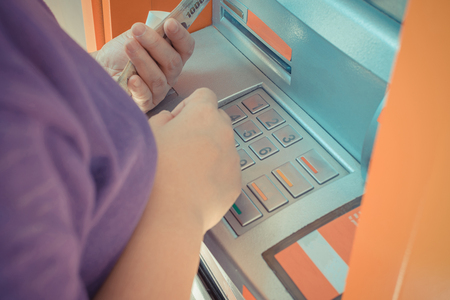pin code: Automated teller machine (ATM) with person have a banknote in hand input pin code on keypad withdraw money , process in vintage style