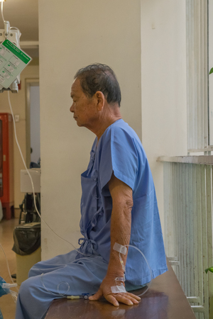 nhs: Bangkok, Thailand - July 19, 2015 : Unidentified patient elderly waiting a doctor and nurse in hospital