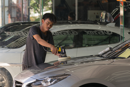 valet: Bangkok, Thailand - December 12, 2015 : Unidentified car care staff cleaning the car. Editorial