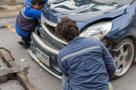 scrap trade: Bangkok, Thailand - June 17, 2016 : Car crash from car accident on the road in a city between saloon versus pickup wait insurance.