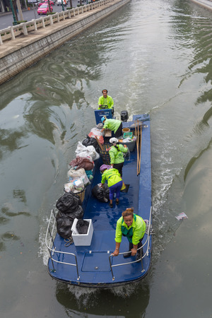 garbage collection: Bangkok, Thailand - May 16, 2016 : Garbage collection boat working in Khlong Phadung Krungkasem is a important canal in downtown Bangkok, Thailand. Editorial