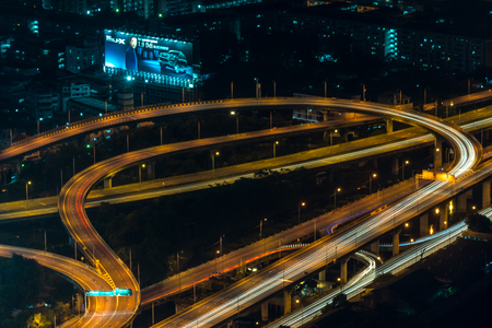Cityscape, Expressway with light of car on road and Bangkok city with building and transportation in nighttime from Skyscraper by long exposure photography Editorial