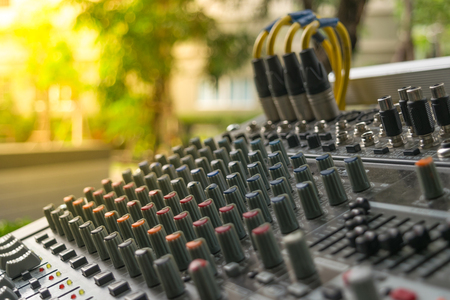 Sound mixer control board with volume buttons. , process in soft orange sun light style Stock Photo