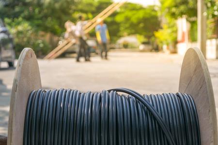 Working for install internet fiber system in village , process in soft orange sun light style Archivio Fotografico