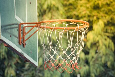 backboard: Basketball hoop make by wooden and ball in park , process in vintage style