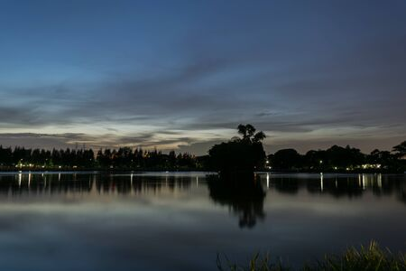 gloaming: Sunset in evening to night time at park and lake