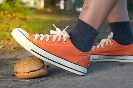 Good bye junk food hamburger left to jogging exercise , process in soft orange sun light style