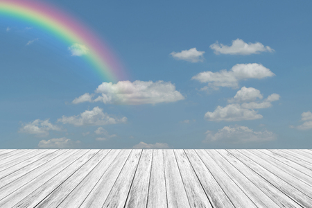 Nature cloudscape with blue sky and white cloud with Wood terrace and rainbow