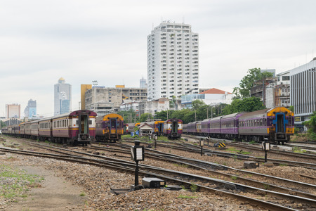 Railway train run on the railroad tracks. Many people in Thailand popular travel by train because it is cheaper.
