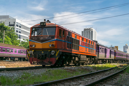 Bangkok, Thailand - August 14, 2015 : Unidentified railway train run on the railroad tracks. Many people in Thailand popular travel by train because it is cheaper. Editorial