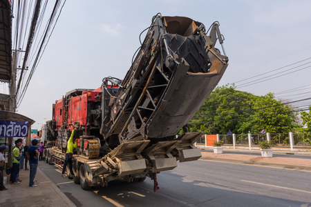 machinerie: Ang Thong, Thailand - May 2, 2016 : Sugar cane harvesters on trailer truck for move to work.