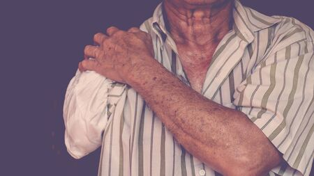 Asia elderly man have tanned skin disabled with one arm and arm prosthetic because accident , process in vintage style Stock Photo