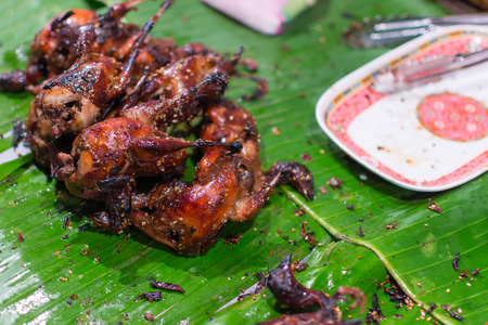 Partridge or quail grilled on a charcoal is a barbeque food from bird sell in Thai street food market