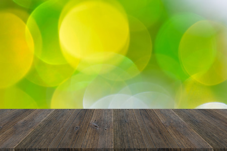 Abstract bokeh background of light for celebration new year and christmas with wood terrace