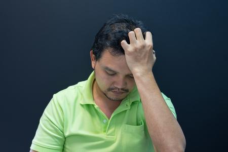 Anxious asian short hair man feeling sadness and stress Stock Photo