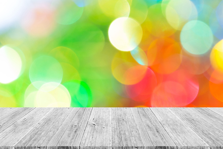 Abstract bokeh background of light for celebration new year and christmas with white wood terrace