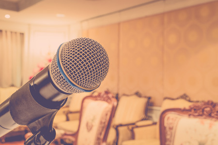 amplify: Microphone in seminar event defocus on meeting room background , process in vintage style