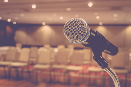 voices: Microphone in seminar event defocus on meeting room background , process in vintage style