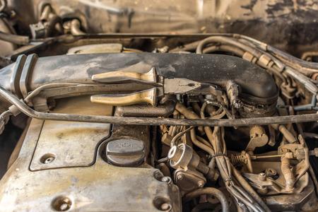 Disassembled car dirty engine close-up to engine parts at car garage
