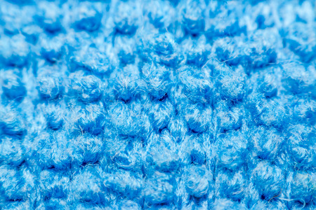 Macro of fabric weave texture surface blue color use for background
