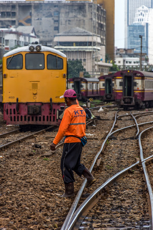 Bangkok, Thailand - August 11, 2016 : Unidentified railway employees working for restoration the railroad tracks before serving at State Railway of Thailand. Editorial