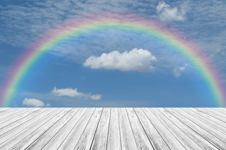 Wood terrace and Blue sky and white cloud with rainbow Stock Photo