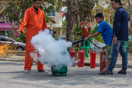 Bangkok, Thailand - March 5, 2017 : Many people preparedness for fire drill and training to use a fire safety tank in village at Bangkok Thailand. Editorial
