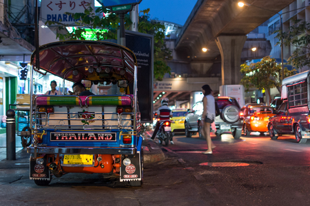 Bangkok, Thailand - February 28, 2017 : Unidentified Thai TukTuk taxi wait for a tourist on footpath at Patpong night market on silom road internationally tourist popular visited to Patpong.