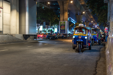 Bangkok, Thailand -March 2, 2017 : Unidentified Thai TukTuk taxi wait for a tourist on footpath at Patpong night market on silom road internationally tourist popular visited to Patpong.