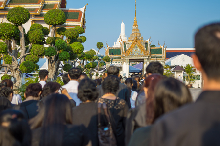 Bangkok, Thailand - March 11, 2017 : Unidentified Thai mourners wearing black color waiting in The Grand Palace to pay tribute and respect to their beloved Rama 9 Thai King Bhumibol Adulyadej