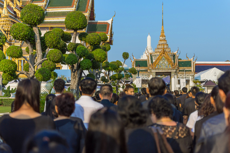 pass away: Bangkok, Thailand - March 11, 2017 : Unidentified Thai mourners wearing black color waiting in The Grand Palace to pay tribute and respect to their beloved Rama 9 Thai King Bhumibol Adulyadej
