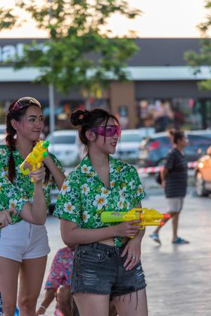 drench: Bangkok, Thailand - April 15, 2017 : Unidentified women play and enjoying splashing with waters gun in Songkran Festival. Editorial