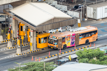 schlagbaum: Bangkok, Thailand - April 12, 2017 : Gate for expressway fee payment in Bangkok by EXAT from skyscraper. EXAT is Expressway Authority of Thailand.