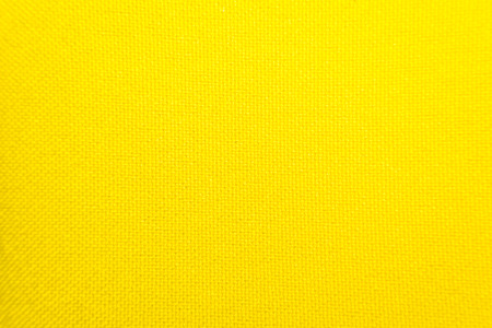Macro of fabric weave texture surface yellow color use for background